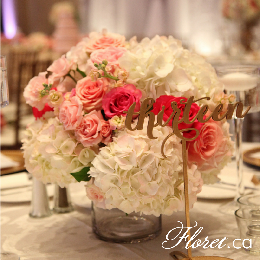Low to table wedding centerpiece at One King West